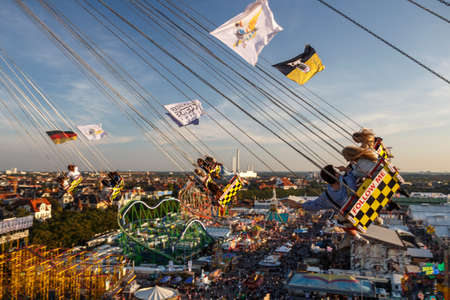 Munich, Germany - September 24, 2016: Carousel in motion with people flying through the air on Theresienwiese Editorial