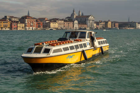 Venice, Italy - November 12, 2016: Lagoon of Venice with it characteristic cityscape and motorboats in front that are used for passenger transports 報道画像