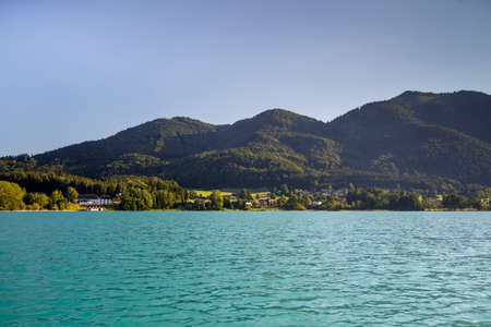 The Fuschlsee during summer season with it's beautiful surrounding landscape 免版税图像