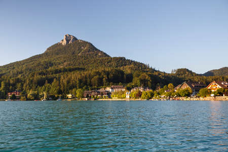 The Fuschlsee during summer season with it's beautiful surrounding landscape and buildings of the city of Fuschl am See