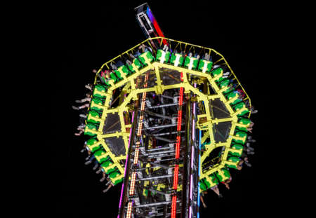 Munich, Germany - September 26, 2015: Nightshot of the Free fall tower at Oktoberfest with 80 meter height Editorial