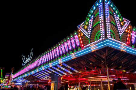 Munich, Germany - September 26, 2015: Illuminated roof of a bumper car attraction at Oktoberfest