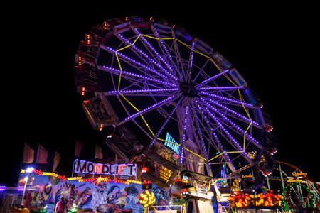 Munich, Germany - September 26, 2015: Nightshot of the Mondlift carousel in motion at Oktoberfest on Theresienwiese