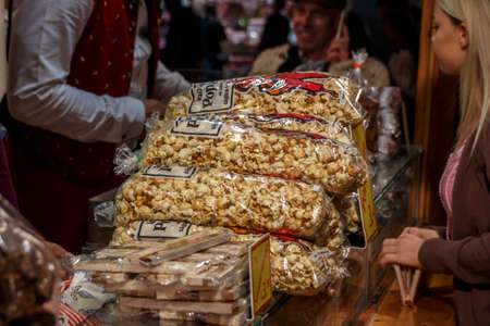 Munich, Germany - September 26, 2015: Sales stall for takeaway food (with popcorn in focus) at Oktoberfest Editorial