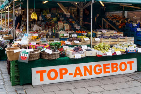 Munich, Germany - September 26, 2015: Sales stall with fresh fruits at Viktualienmarkt in Munich, the Viktualienmarkt is a typical farmers market Editorial