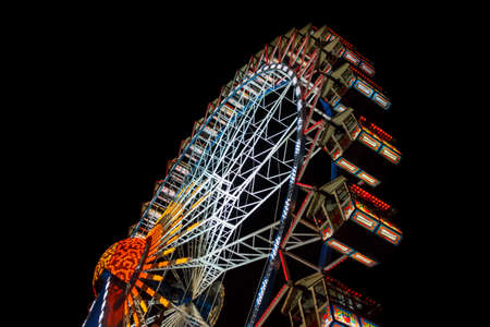 Munich, Germany - September 26, 2015: Ferris wheel on the fairground of the Octoberfest in Munich at night Editorial