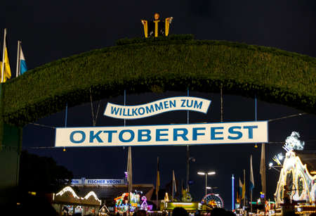 Munich, Germany - September 26, 2015: Nightshot of the main entrance gate to the Oktoberfest at Theresienwiese in Munich Editorial