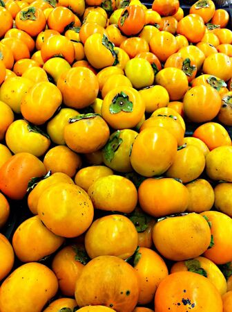 persimmons: Close up of persimmons Stock Photo