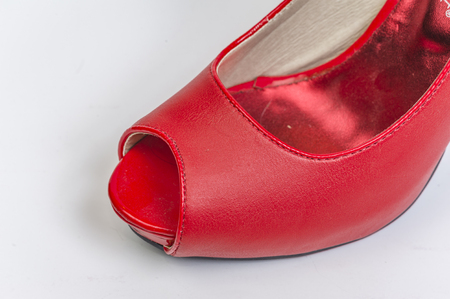 Tip of a red peeptoe high heel