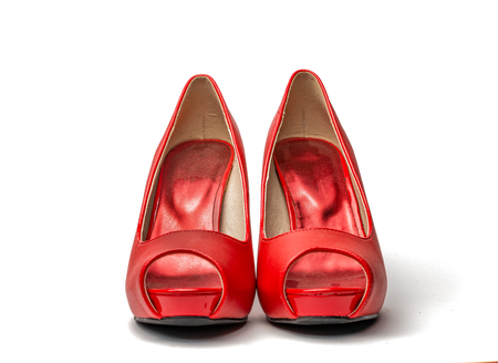 Red high heel shoes in front of white clean background with shadows Stock Photo