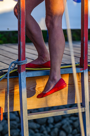 red pumps on a ladder