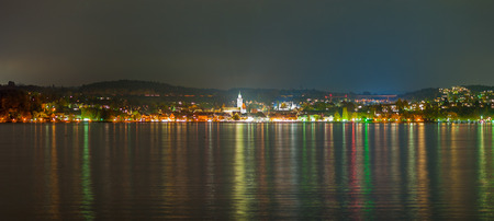 panorama of a city at lake constance during nighttime