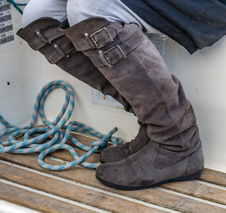 grey boots on a sailboat