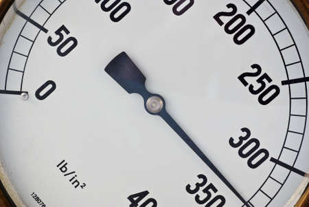 incremental: An old pressure gauge shows that the pressure is building Stock Photo
