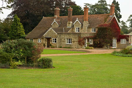 english garden: A stone and pantile English country house