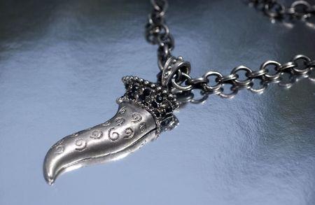 silver pendant lucky on back grey nuanced                             Archivio Fotografico