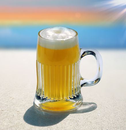 glass of blond beer on beach background Stock Photo - 3338025