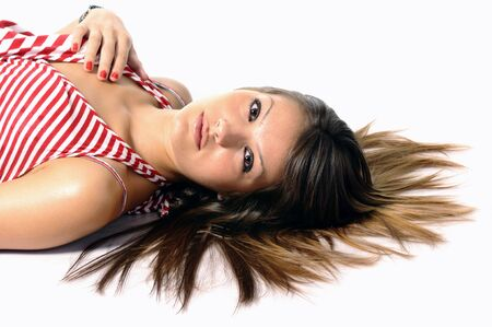 serious young woman lying on a white background Stock Photo - 3556759