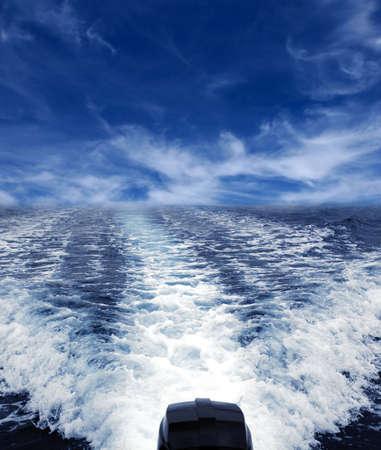 white wake of a boat motor photo