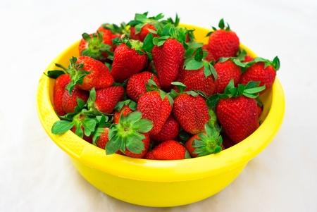fresh strawberry in the yellow bowl