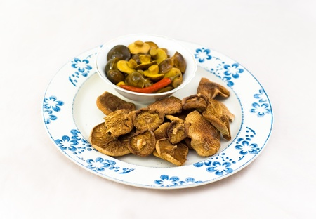 Dried and marinaded mushrooms Stock Photo