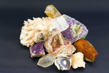 composition of natural gem stones on a black background photo