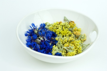 Immortelle with cornflower in a bowl photo