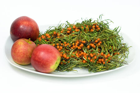 bacca: fresh buckthorn with apples on a white background