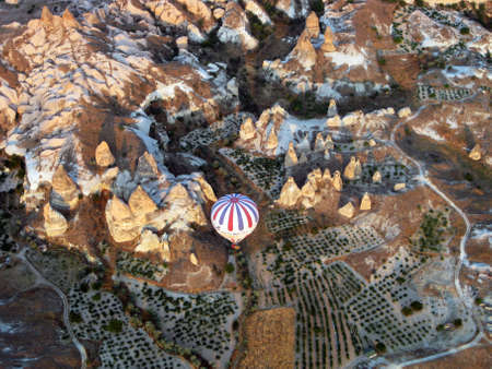 Hot air ballon over doves valley Cappadocia Turkey photo