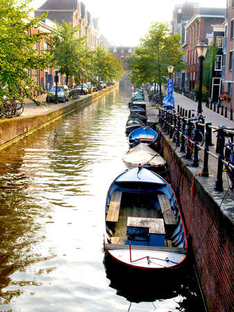 dutch: Small boats in a canal in Amsterdam        Stock Photo