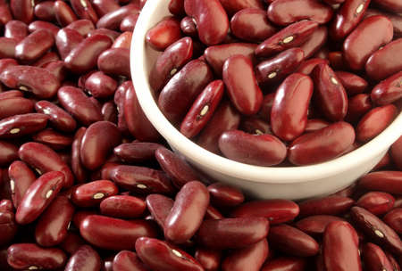 A close up of a measuring cup full of red beans. Zdjęcie Seryjne
