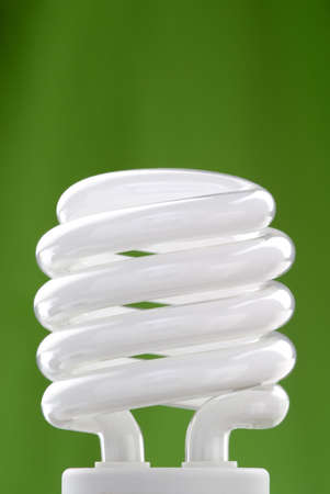 Compact fluorescent bulb with a green background.