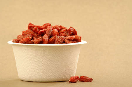 Organic Goji berries in a recyclable cup.