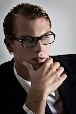 Young businessman thinking with a calm attitude  photo