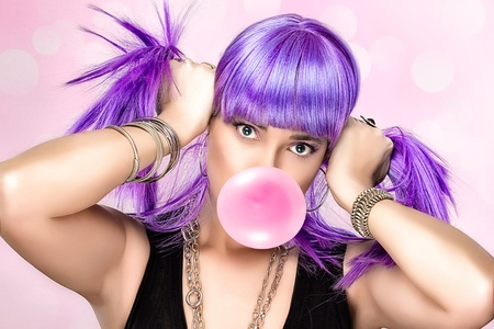 gums: Portrait of beauty party girl with purple wig and pink bubble gum