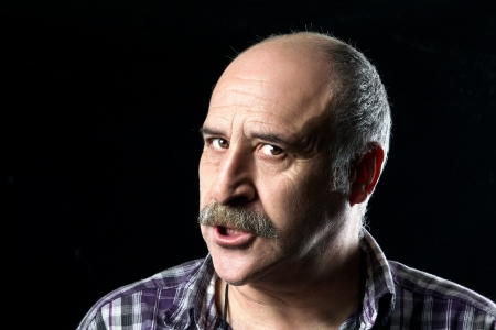 Portrait of annoyed bald man with a big mustache expressing anger photo