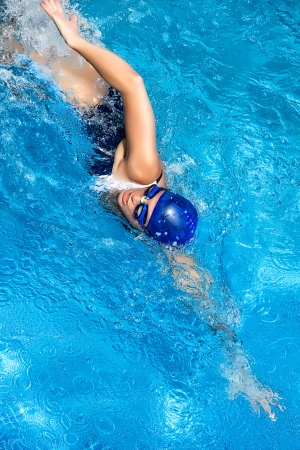 freestyle: Young woman swimming in freestyle