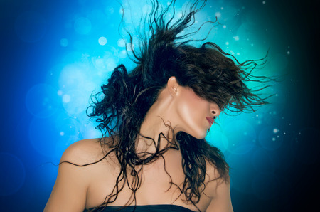flying woman: Portrait of woman brunette with hair flying