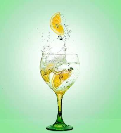 Glass of gin and tonic with lemon photo