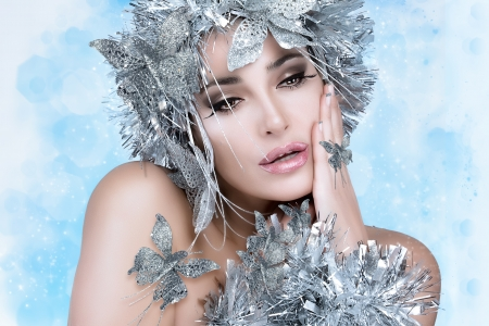 Fashionable woman portrait with festive makeup, manicure and vibrant silver hair styling  Vogue style model photo