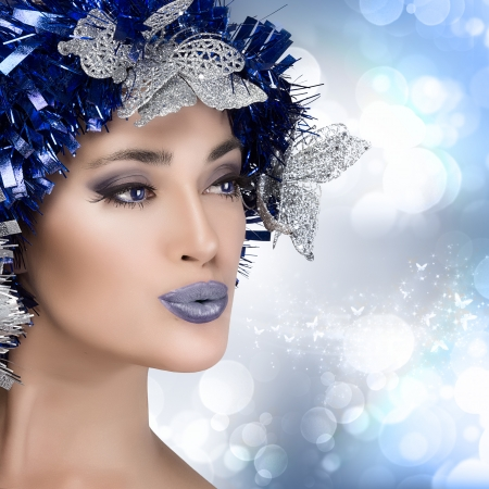 Beauty christmas girl with festive makeup in blue and silver photo