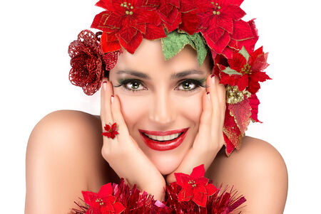 Cheerful party girl with makeup, manicure and floral hairstyle in gold and red isolated on white background photo