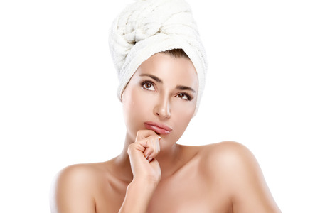 Spa woman with towel on head thinking looking up. Haircare and bodycare concept. Closeup portrait isolated on white photo