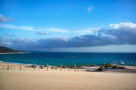cadiz: Valdevaqueros beach overlooking Tarifa and Africa. Andalusia landscape. Vegetation protected in Valdevaqueros Cove. Cadiz. Spain.