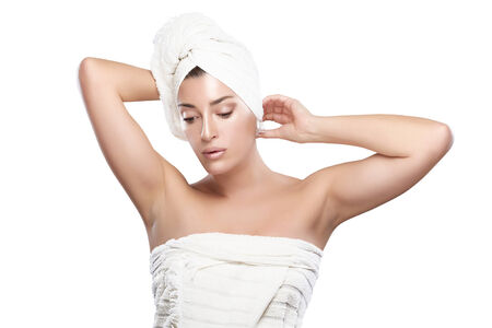 Thoughtful spa woman in towel after bath. Haircare and bodycare concept. Portrait isolated on white photo