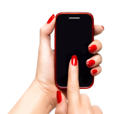 Elegant female hands with red nails holding a smartphone and pointing the touchscreen. Closeup isolated on white photo