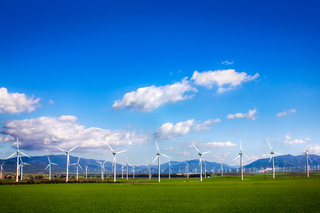windy energy: Windmills on green meadow  Facinas, Cadiz, Spain Stock Photo