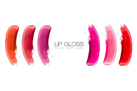 lapiz labial: Muestras de colores de brillo de labios aislados en blanco con el texto de ejemplo. Belleza y el concepto de maquillaje