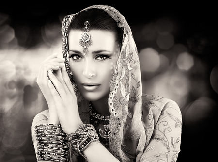 indian bride: Beautiful hindu woman with traditional clothes, jewelry and makeup. Black and white portrait Stock Photo