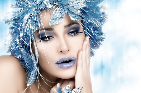 Professional holiday makeup and fancy hairstyle.  photo